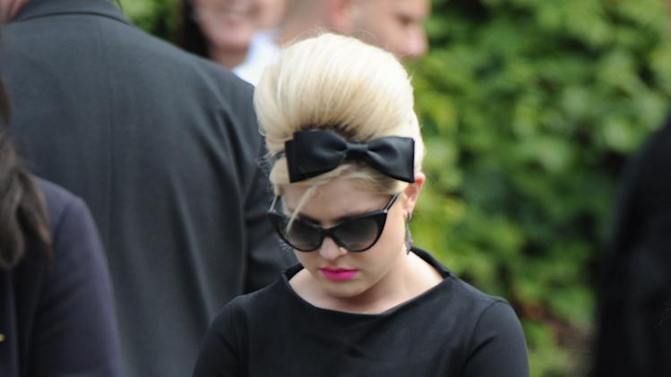 Media personality Kelly Osbourne, leaves Golders Green, Crematorium in London, Tuesday, July 26, 2011, after attending the funeral of singer Amy Winehouse.  The soul diva, who had battled alcohol and drug addiction, was found dead Saturday at her London home. She was 27. (AP Photo/Joel Ryan)