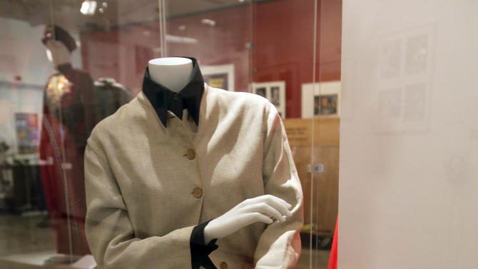 "A suit worn during publicity photos for the 1967 movie ""Guess Who's Coming to Dinner,"" is shown as part of the ""Katharine Hepburn: Dressed for Stage and Screen"" exhibit in the New York Public Library for the Performing Arts at Lincoln Center,  Tuesday, Oct. 16, 2012. (AP Photo/Richard Drew)"