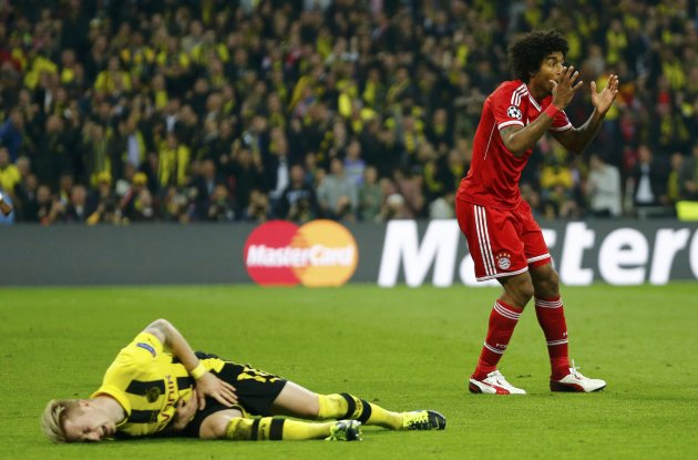 Bayern Munich's Dante reacts after fouling Borussia Dortmund's Marco Reus during the Champions League Final soccer match at Wembley Stadium in London