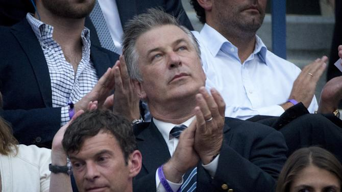 Actor Alec Baldwin applauds as he attends the match between Williams of the U.S. and Diatchenko of Russia at the U.S. Open Championships tennis tournament in New York