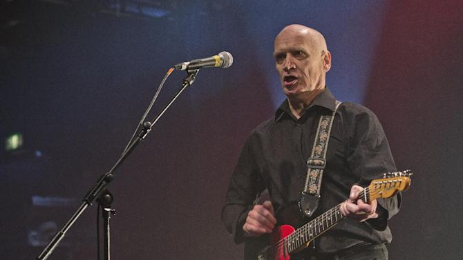 """FILE - A Wednesday, Mar. 6, 2013 file photo showing Wilko Johnson, guitarist and founding member of Dr. Feelgood, performing at one of four farewell concerts in the UK, at the Koko club in north London. Johnson says he is free of cancer, two years after being told he had months to live. Accepting a trophy Wednesday, Oct. 22, 2014, at the Q Awards, 67-year-old Johnson said he had undergone radical surgery to remove a 3-kilogram (6.6-pound) tumor. He said: """"They cured me."""" Johnson said he hoped to go back on the road soon, """"and the moral of the story is you never know what's going to happen."""" (Photo by Joel Ryan/Invision/AP)"""