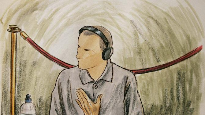 FILE - In this Aug. 26, 2004, file courtroom sketch, Ali Hamza al Bahlul appears before a military commission at Guantanamo Naval Base in Guantanamo, Cuba. A federal appeals court on Monday, July 14 set aside two of three convictions against a former personal assistant to Osama bin Laden. The U.S. Court of Appeals for the District of Columbia Circuit issued the ruling in the case of Ali Hamza al-Bahlul, who produced propaganda videos for al-Qaida and assisted with preparations for the terrorist attacks of Sept. 11, 2001. (AP/Art Lien, pool)