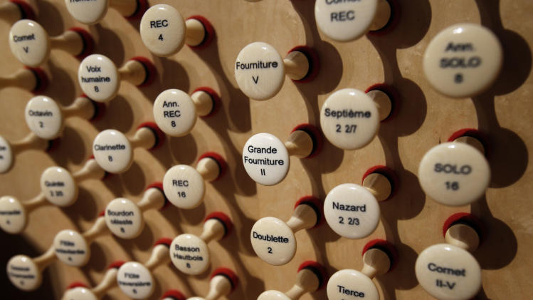 This Thursday May 2, 2013 photo shows pipe organ stops at Notre Dame cathedral in Paris. The organ was refurbished for the cathedral's 850th anniversary this year. (AP Photo/Christophe Ena)