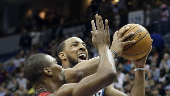 Minnesota Timberwolves' Derrick Williams, right, eyes the basket for a shot as Miami Heat's Chris Bosh defends in the first half of an NBA basketball game Monday, March 4, 2013, in Minneapolis. (AP Photo/Jim Mone)