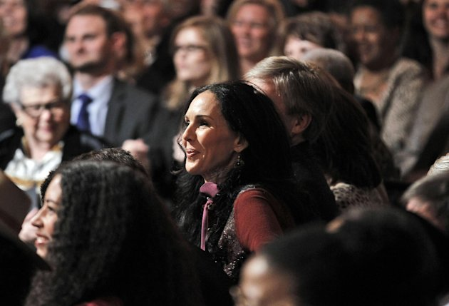 L'Wren Scott, center, fashion designer and long-time companion of Mick Jagger, is seen in the audience during the White House Music Series saluting Blues Music in recognition of Black History Month, Tuesday, Feb. 21, 2012, in the East Room of the White House in Washington. (AP Photo/Pablo Martinez Monsivais)