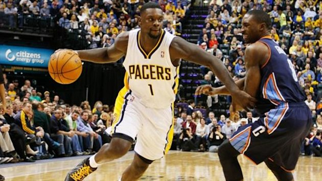 Indiana Pacers guard Lance Stephenson drives to the basket against Charlotte Bobcats guard Ben Gordon (Reuters)