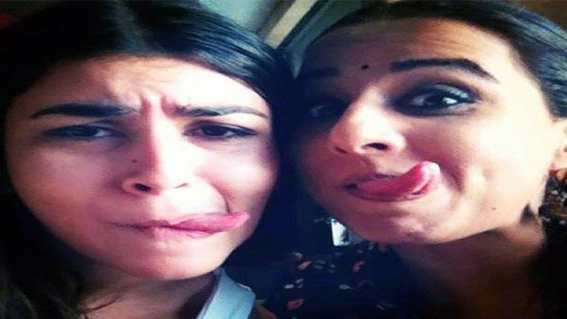 Why Vidya is making faces?