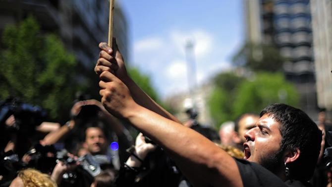 A protester shouts slogan during a demonstration against austerity cuts in Barcelona, Spain, Tuesday, May 15, 2012. Spain got caught up in the uncertainty surrounding the European single currency and the electoral stalemate in Greece Monday as it saw its borrowing costs rise and stock prices fall at alarming rates. (AP Photo/Manu Fernandez)