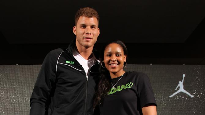 Jordan Brand athletes, Blake Griffin and Maya Moore pose at Jordan Brand's Flight Experience on Saturday, February 16, 2013 in Houston, TX. (Photo by Omar Vega/Invision for Jordan Brand/AP Images)