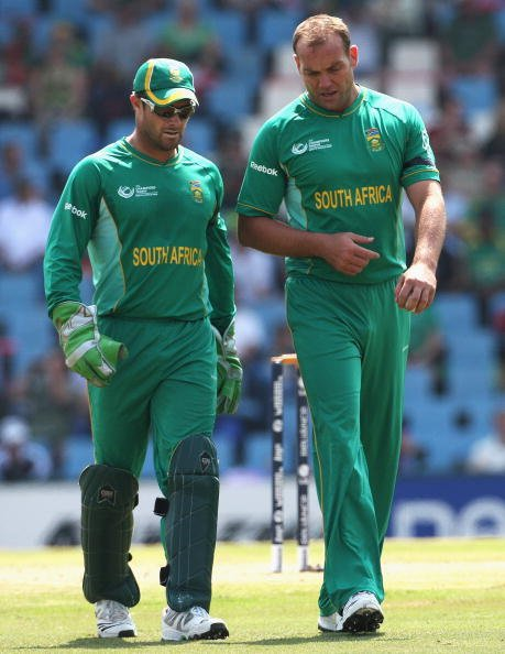 CENTURION, SOUTH AFRICA - SEPTEMBER 24:  Mark Boucher (L) and Jacques Kallis of South Africa talk during the ICC Champions Trophy Group B match between South Africa and New Zealand on September 24, 20