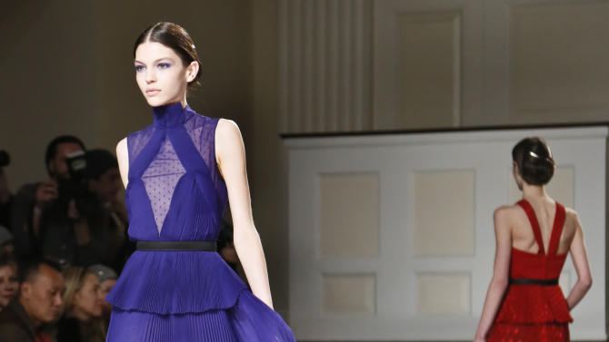 Fashion from the Fall 2013 collection of Jason Wu is modeled on Friday, Feb. 8, 2013 in New York.  (AP Photo/Bebeto Matthews)