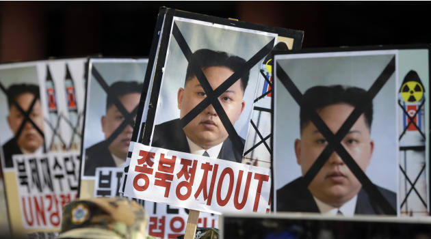 South Korean protesters hold the pictures of North Korean leader Kim Jong Un during a rally denouncing North Korea's rocket launch in Seoul, South Korea, Wednesday, Dec. 12, 2012. North Korea successf