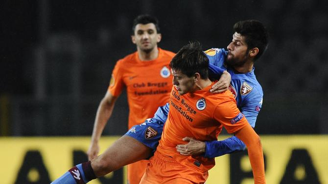 Torino's Benassi fights for the ball with Club Brugge's Castillo during their Europa League Group B soccer match in Turin