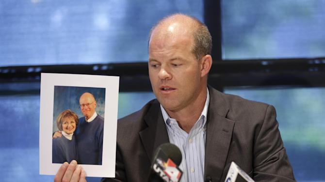 Attorney Paxton Guymon holds a photograph of Jim and Jan Harding during a news conference in Salt Lake City on Thursday, Aug. 14, 2014. Jan Harding, 67, is in critical condition at a Salt Lake City hospital's burn unit, unable to talk and fighting for her life, Guymon said. She drank sweet tea containing a toxic cleaning chemical, severely burning her mouth and throat at a Utah restaurant after an employee mistook the substance for sugar and mixed it into a dispenser, Guymon said. (AP Photo/Rick Bowmer) (AP Photo/Rick Bowmer)