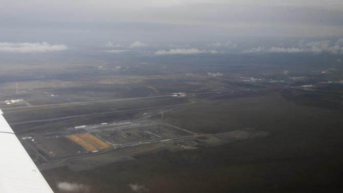 A portion of the Hanford Nuclear Reservation is seen from the air, Wednesday, March 6, 2013, near Richland, Wash. Washington Gov. Jay Inslee was in the area Wednesday to tour the facility and meet with Dept. of Energy officials in order to learn more about tanks on the site that are leaking radioactive waste. (AP Photo/Ted S. Warren)