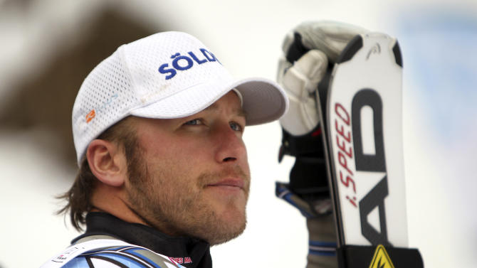 FILE - In this Jan. 13, 2012 file photo, Bode Miller, of the United States, looks at the scoreboard after finishing third in a alpine ski, men's World Cup super-combined, in Wengen, Switzerland. Miller will undergo another surgery on his balky left knee and miss the remainder of the World Cup season. (AP Photo/Marco Trovati, File)