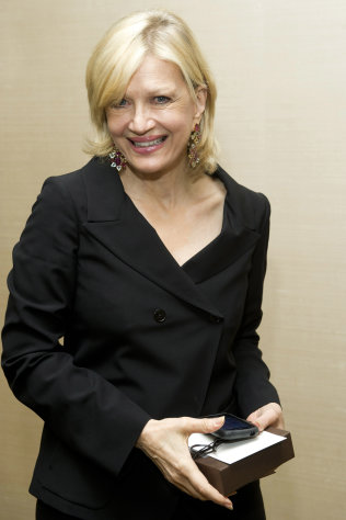 FILE - In this March 24, 2012 photo, Diane Sawyer attends Aretha Franklin's seventieth birthday party in New York. Sawyer's Election Night performance left some viewers asking if she had begun celebrating Tuesday's election a bit early. (AP Photo/Charles Sykes, File)