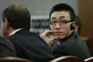 FILE - Xiao Ye Bai listens in Clark County Court as attorneys for the defense speak during arguments in his sentencing in this file photo taken Wednesday, Nov. 28, 2012, in Las Vegas. Bai will be sentenced Tuesday to life in a Nevada prison without parole for murder, but could get more than 100 additional years on other charges for a bloody stabbing and slashing that left one man dead and two people wounded in a Las Vegas karaoke bar. (AP Photo/Julie Jacobson, File)