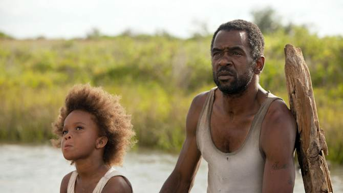 """This film image released by Fox Searchlight Pictures shows Quvenzhane Wallis portraying Hushpuppy, left, and Dwight Henry as Wink in a scene from, """"Beasts of the Southern Wild."""" (AP Photo/Fox Searchlight Pictures, Jess Pinkham)"""