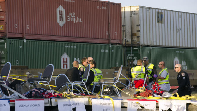 "Midland police, fire and sheriffs respond to an accident where a trailer carrying veterans in a parade was struck by a train crossing in Midland, Texas, Thursday, Nov. 15, 2012. ""Show of Support"" president and founder Terry Johnson tells the Midland Reporter-Telegram that a Union Pacific train slammed into the trailer that was on its way to a wounded veterans event, resulting in multiple injuries. (AP Photo/Reporter-Telegram, Tim Fischer)"