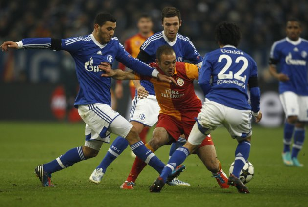 Schalke 04's Kolasinac, oeger and chida tackle Galatasaray's Amrabat during the Champions League soccer match in Gelsenkirchen