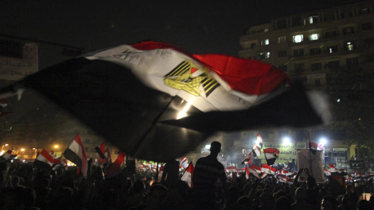"""Egyptians celebrate the victory of Mohammed Morsi in Cairo's Tahrir Square Monday, June 25, 2012. The Muslim Brotherhood's Mohammed Morsi was declared the winner of Egypt's first free presidential election Sunday, and he proclaimed himself a leader """"for all Egyptians,"""" although he faces a struggle for power with the country's still-dominant military rulers. (AP Photo/Thomas Hartwell)"""
