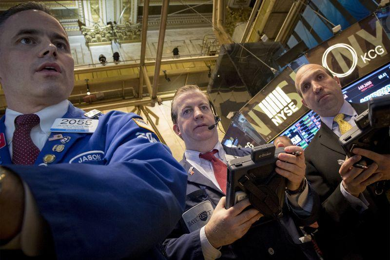 Wall St. falls; European shares rise on optimism over Greece