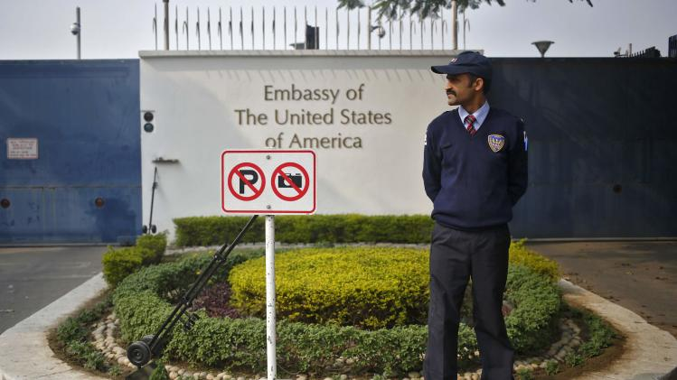 A private security guard stands outside the U.S. embassy in New Delhi