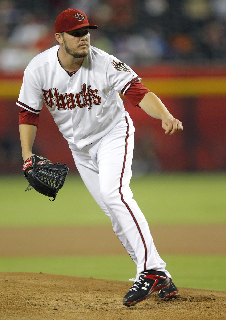 Arizona Diamondbacks pitcher Wade Miley follows through against the New York Mets during the first inning of a baseball game on Thursday, July 26, 2012, in Phoenix. (AP Photo/Matt York)