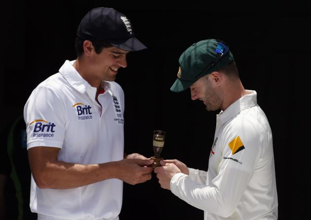 Australia's cricket team captain Clarke holds a replica of the Ashes urn with England's team captain Cook in Brisbane