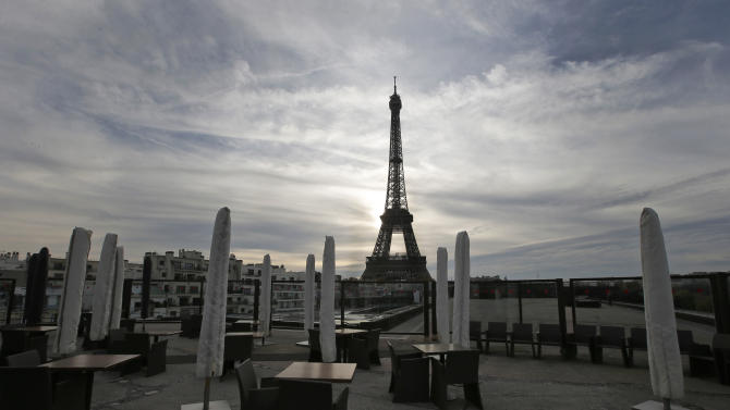 The suns sets on an empty restaurant terrace near the Eiffel Tower in Paris, Tuesday, Nov. 20, 2012. In a setback for President Francois Hollande's Socialist government, Moody's Investors Service stripped Europe's No. 2 economy of it of its prized AAA credit rating late Monday on concerns that its rigid labor market and exposure to Europe's financial crisis were threatening its prospects for economic growth. (AP Photo/Francois Mori)