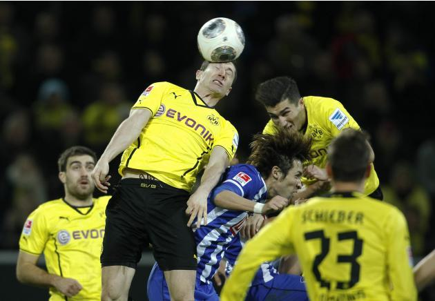 Hertha Berlin's Hosogai, Borussia Dortmund's Lewandowski and Sahin head a ball during the German first division Bundesliga soccer match in Dortmund