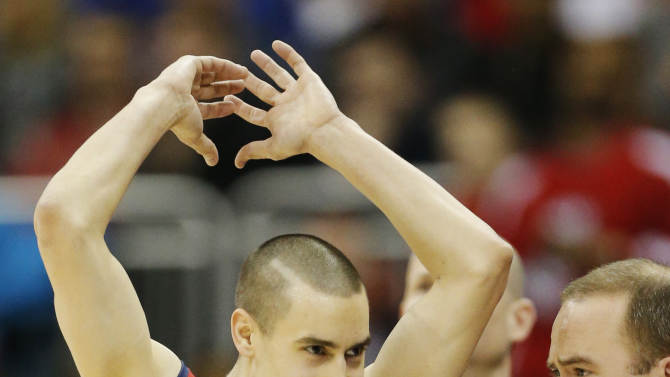 Mississippi guard Marshall Henderson (22) celebrates following a second-round game against Wisconsin in the NCAA basketball tournament at the Sprint Center in Kansas City, Mo., Friday, March 22, 2013. Mississippi defeated Wisconsin 57-46.(AP Photo/Orlin Wagner)