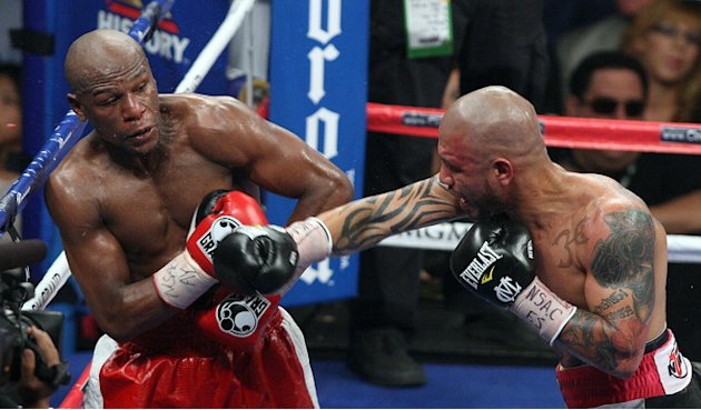 Floyd Mayweather (L) Backs AFP/Getty Images
