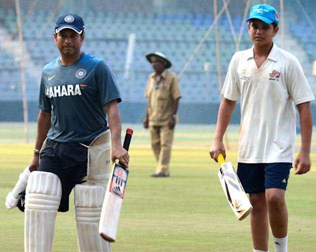 Indian cricketer Sachin Tendulkar with his son arjun Tendulkar during practice session ahead of his 200th and the last Test match at Wankhede stadium in Mumbai on Nov.12, 2013. (Photo: Sandeep Mahanka