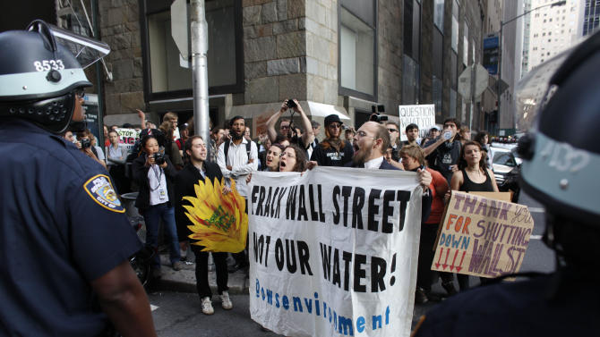 Protestors and police face off during an Occupy Wall Street march, Monday, Sept. 17, 2012, in New York. A handful of Occupy Wall Street protestors were arrested during a march on the New York Stock Exchange on the anniversary of the grass-roots movement. (AP Photo/Jason DeCrow)