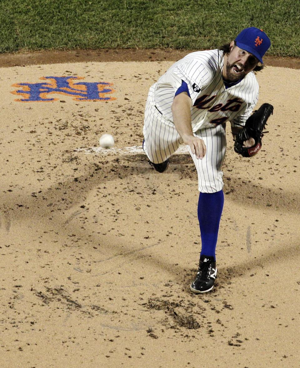 New York Mets starting pitcher R.A. Dickey throws during the second inning of a baseball game against the New York Yankees at Citi Field in New York, Sunday, June 24, 2012. (AP Photo/Peter Morgan)