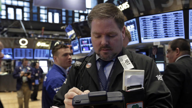 Trader Thomas McCauley, center, works on the floor of the New York Stock Exchange Monday, Feb. 25, 2013. Stocks are opening higher on Wall Street, following the first weekly decline in the S&P 500 index this year. (AP Photo/Richard Drew)