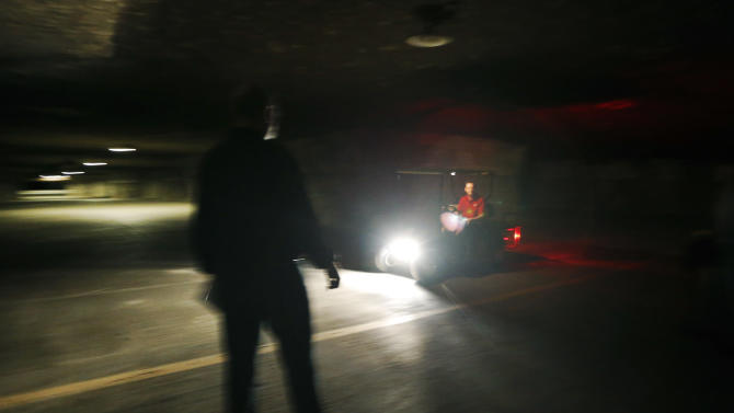 Coby Cullins drives a golf cart in the Vivos Shelter and Resort during a tour of the facility in Atchison, Kan., Tuesday, June 18, 2013. (AP Photo/Orlin Wagner)