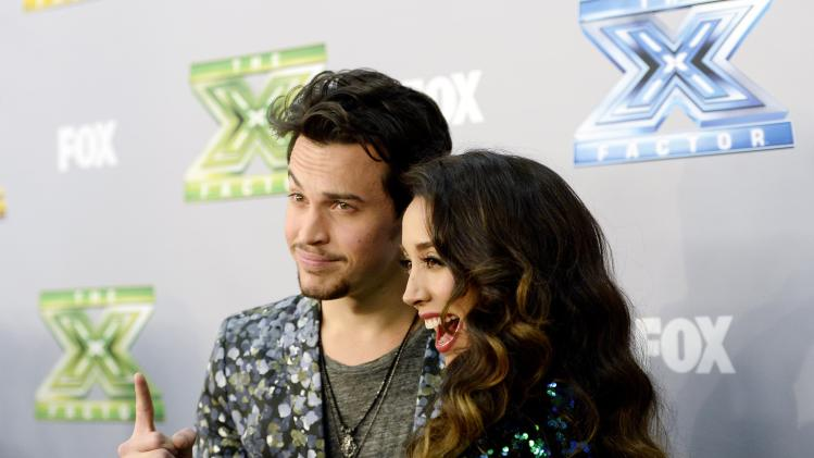 "Alex Kinsey and Sierra Deaton pose backstage after the folk duo won ""The X Factor "" in Los Angeles"