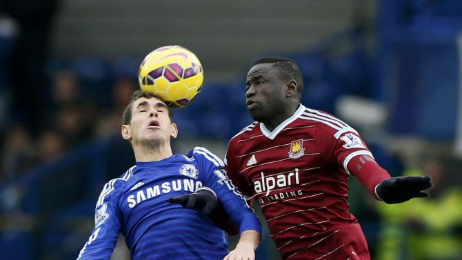 Chelsea's Oscar challenges West Ham United's Cheikhou Kouyate during their English Premier League soccer match at Stamford Bridge in London