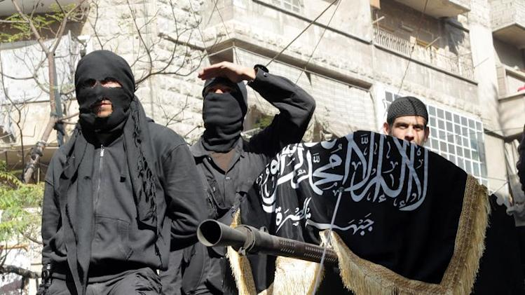 Members of jihadist group Al-Nusra Front take part in a parade calling for the establishment of an Islamic state in Syria, at the Bustan al-Qasr neighbourhood of Aleppo on October 25, 2013