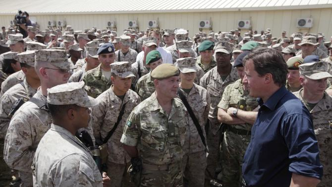 Britain's Prime Minister David Cameron talks with British and US troops during a visit at Camp Bastion, outside Lashkar Gah, the provincial capital of Helmand province in south Afghanistan, Monday, July 4, 2011. (AP Photo/Lefteris Pitarakis, pool)