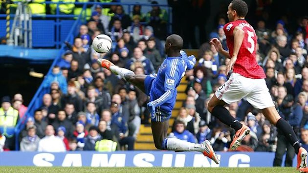 Chelsea's Demba Ba scores against Manchester United during their English FA Cup quarter-final replay soccer match at Stamford Bridge in London (Reuters)