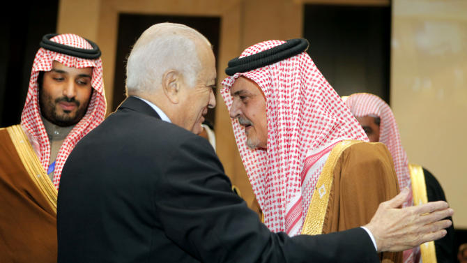 Saudi Foreign Minister Prince Saud al-Faisal, right, is greeted by Arab League chief Nabil Elaraby, center, at the12th summit of the Organization of Islamic Cooperation in Cairo, Egypt, Wednesday, Feb. 6, 2013.  The summit aims to address a wide range of issues including, Palestinian statehood, the Syrian crisis, poverty in the Islamic world and conflicts in Afghanistan and Somalia. (AP Photo/Amr Nabil)