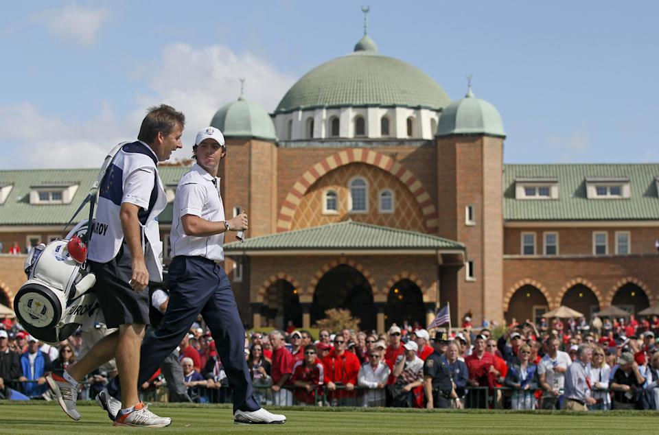 Europe's Rory McIlroy walks off the first tee during a singles match at the Ryder Cup PGA golf tournament Sunday, Sept. 30, 2012, at the Medinah Country Club in Medinah, Ill. (AP Photo/Charles Rex Arbogast)