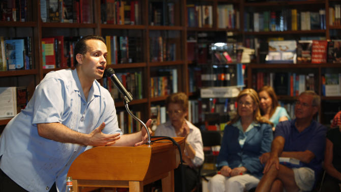 """In this June 28, 2011 photo, formerU.S. Army Captain Luis Carlos Montalvan speaks at a book signing for his book """"Until Tuesday,"""" at a book store in Coral Gables, Fla. Since serving two tours of duty, for which he received two Bronze Stars and the Purple Heart, the former Army captain has become a strong critic of the war and an advocate for better care of those who served.  (AP Photo/Wilfredo Lee)"""