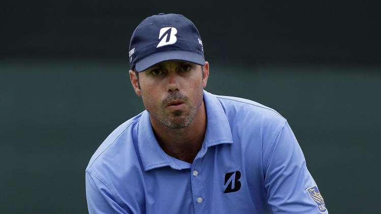 Matt Kuchar lines up a putt on the ninth hole during the second round of the Colonial golf tournament on Friday, May 24, 2013, in Fort Worth, Texas.  (AP Photo/LM Otero)