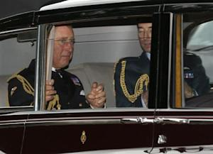 Britain's Prince Charles arrives for the christening of Prince George at St James's Palace in London
