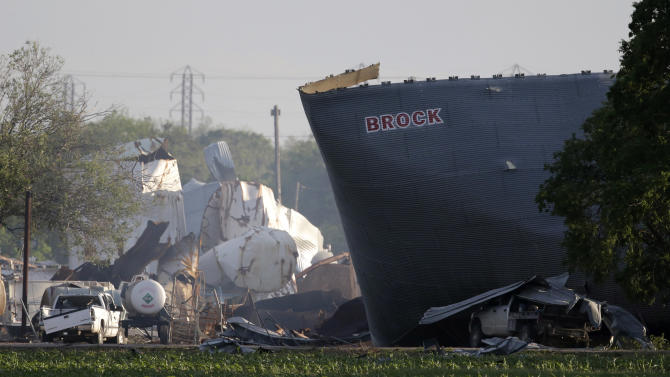 Mangled debris of a fertilizer plant are seen Thursday, April 18, 2013, a day after an explosion leveled the plant in West, Texas. The massive explosion at the West Fertilizer Co. Wednesday night killed as many as 15 people and injured more than 160. (AP Photo/Charlie Riedel)